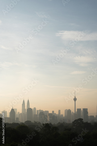 vertical or potrait image of Beautiful Kuala Lumpur cityscape skyline in the morning environment and the buildings in silhouette Poster