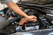 Professional check engine cars details and cleaning before traveling with microfiber