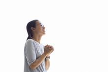 Woman Praying On Holy Bible