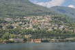 Panoramic view of quaint traditional waterfront houses on majestic Lake Como, Lombardy, Italy.