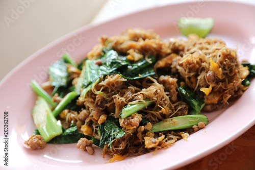Photo  Stir fried Noodle with black soy sauce thai food