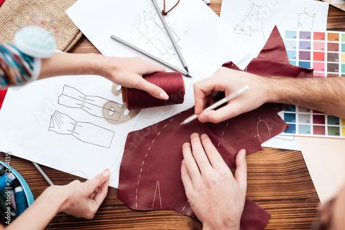 Obraz na plátně  Top view two fashion designers making cutout.
