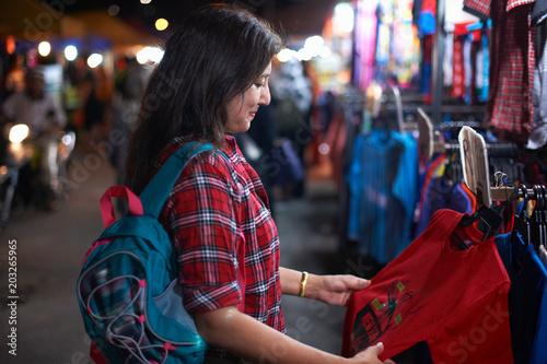 Tourist shopping at night market, Kuala Lumpur, Malaysia