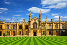 University In Cambridge With A Beautiful Lawn Under A Blue Sky On A Sunny Day   In Summer