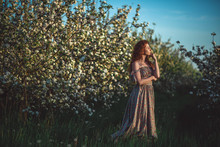 Red-haired Girl In A Blooming Garden