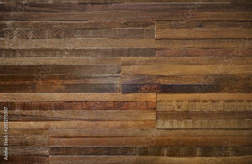 thick wood block wall of reclaimed wood with rough texture