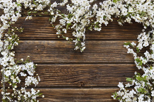 Close-up photo of Beautiful white Flowering Cherry Tree branchesheart shape on vintage wooden background Wallpaper Mural