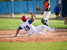Baseball Player Sliding Into T...