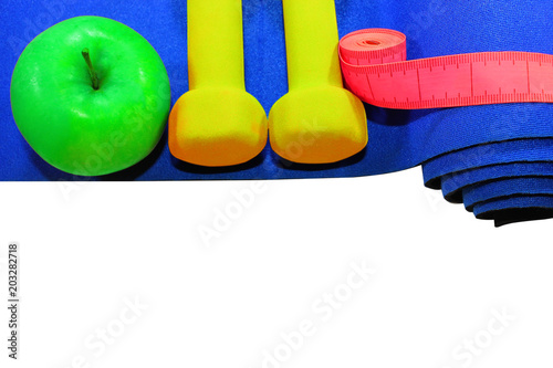 d7cff16cf7d77 blue mat with dumbbells green apple drink measuring tape isolated on white  background, healthy lifestyle