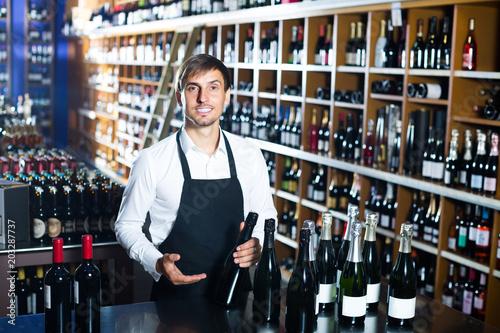 male seller in wine store.