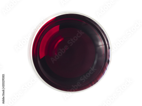 Fotografie, Obraz  Glas of red wine pictured from above on white surface