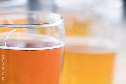 Macro close up on a pint of craft beer with suds on the surface Canvas Print