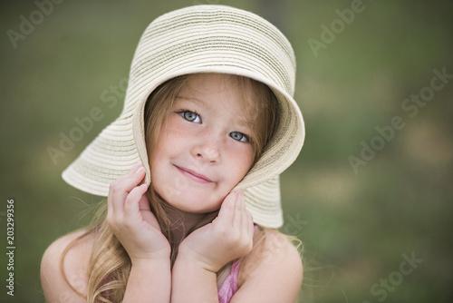 Portrait of smiling girl in hat