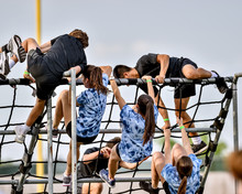 Athletes Competing On An Obsta...