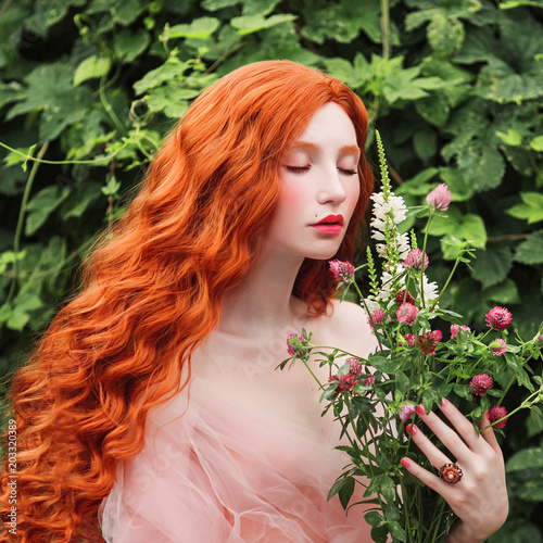 Beautiful pre-raphaelite girl with curly red hair with a flying tulle dress on t Poster