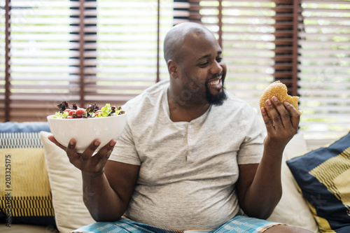 Valokuva  Man chosing what to eat