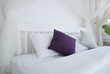 pillows on white bed