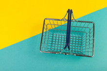 Shopping Basket On A Colored B...