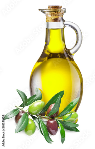 Bottle of olive oil and olive twig with berries near it. Clipping path.