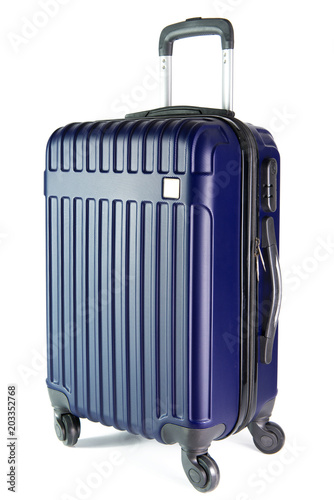 Photo Blue color travel suitcase isolated on white background.