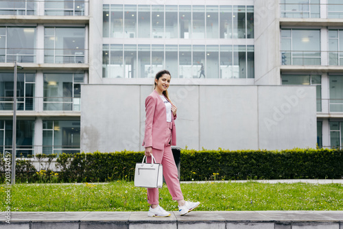 Stylish model in pink on street