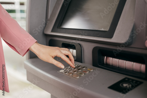 Woman entering security code for credit card