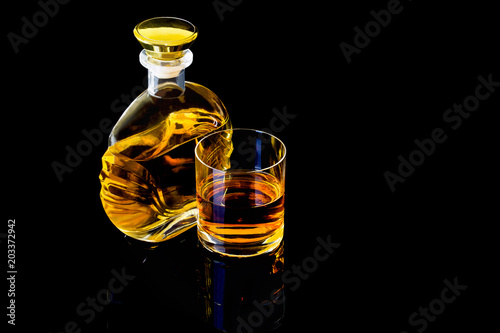 Tuinposter Bar Decanter and a glass of whiskey on a black background