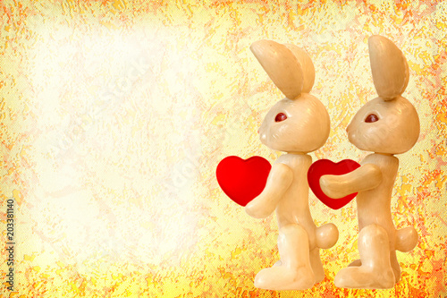 Foto auf AluDibond Ziehen knitted rabbit with a heart.