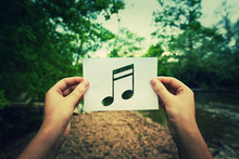 Holding Music Note