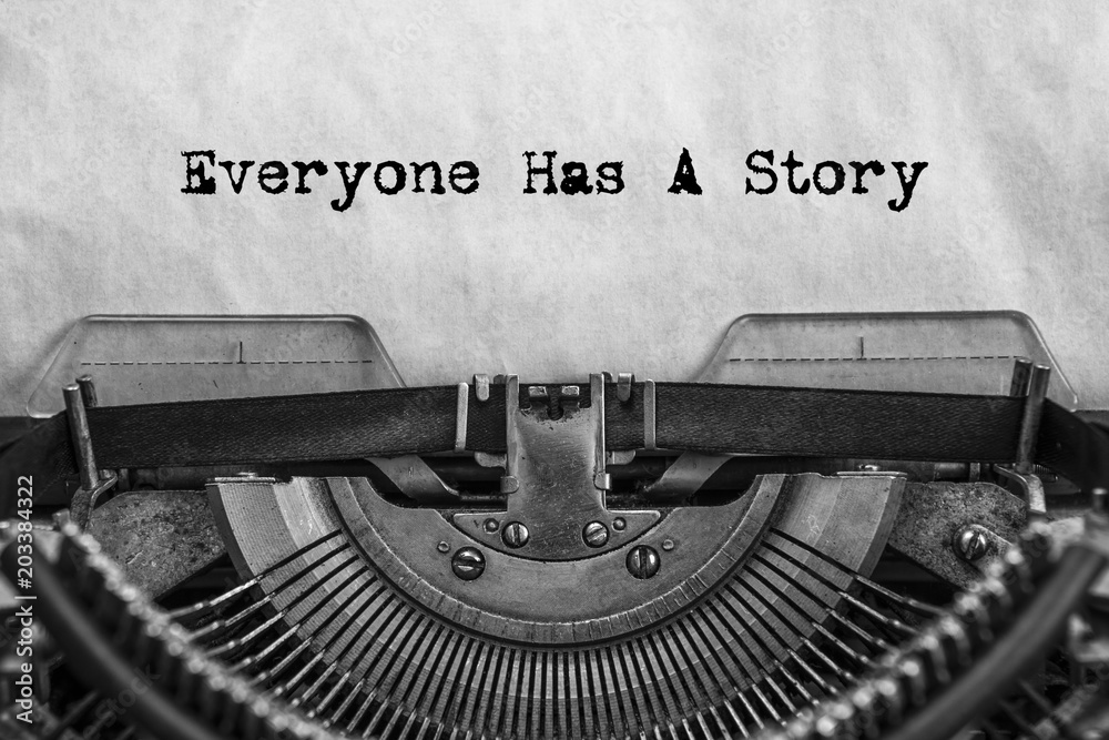 Fototapeta Everyone Has A Story, typed words on a vintage typewriter. old paper. close-up. my history
