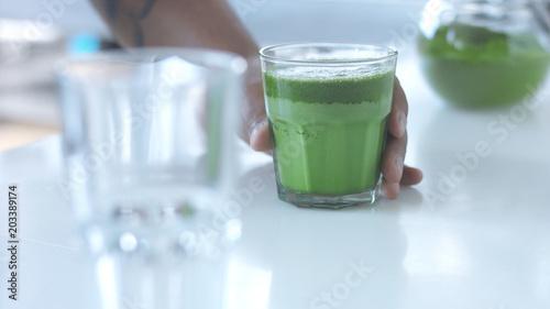 glass with a mathca tee closeup of glass with matcha