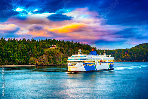 VICTORIA, BC - APRIL 8, 2018: Large multi-level ferries carry cars, trucks, and passengers hourly between Vancouver and Victoria as seen near Victoria in April 2018.