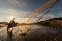Fisherman Use Equipment For Catch A Fish.