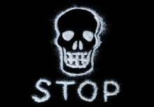 Skull Painted With White Sugar And Text Stop On A Black Background. Caution Sign