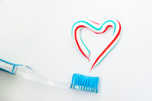 The Heart Symbol Is Made From A Three-color Toothpaste And Is Located Above The Toothbrush