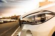 luxury white car head lamp. sunlight