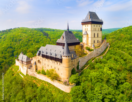 Spoed Fotobehang Kasteel Aerial view to The Karlstejn castle. Royal palace founded King Charles IV. Amazing gothic monument in Czech Republic, Europe.