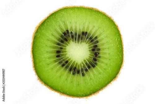 Slice of fresh kiwi fruit isolated on white background. Top view.