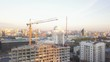 Construction site with cranes. Video. Construction workers are building. Aerial view. Top view of the construction site in the city. Construction in the city with a crane manipulator
