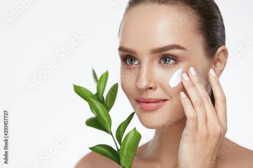 Fotografie, Obraz  Beauty Face Care. Woman With Cream On Facial Skin
