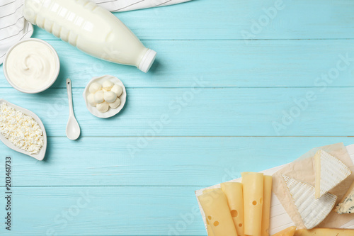 Photo sur Toile Produit laitier Flat lay composition with different dairy products on wooden background
