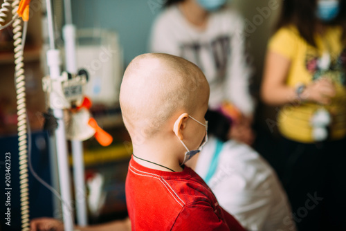 Fotografie, Obraz  oncological child is playing in hospital in medical mask