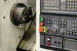 The CNC lathe or turning machine with the controller board.The modern machining process.