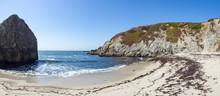Beach And Dramatic Cliffs At B...