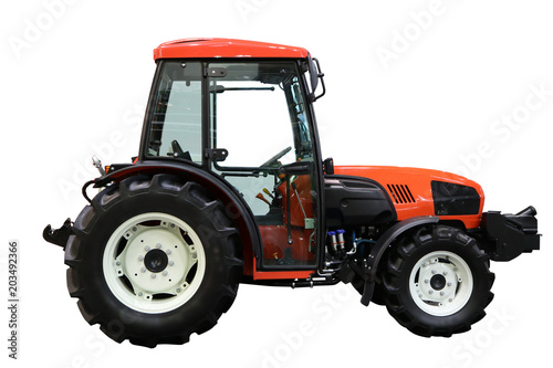 Red tractor. Side view. Isolated on white.