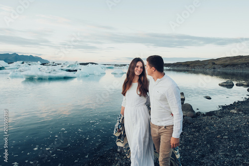 Tuinposter Groen blauw Happy stylish smiling couple walking and kissing in Iceland , on