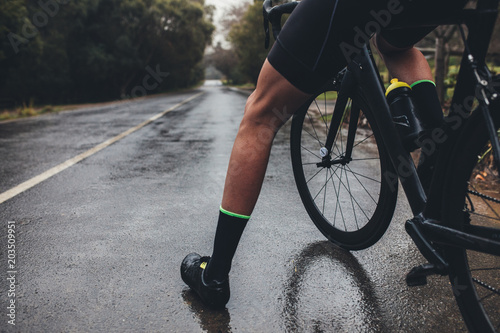 Garden Poster Cycling Cyclist training on wet road