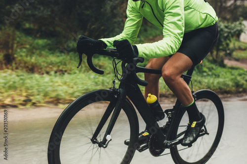 Foto auf Gartenposter Radsport Professional cyclist riding bike