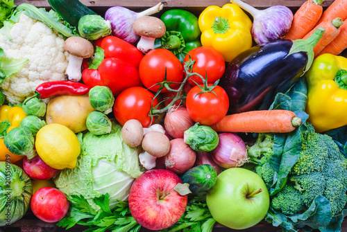 Fotobehang Groenten Vegetables and fruits top view background.