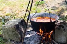 Gulyas Stew Boiling In A Cauld...